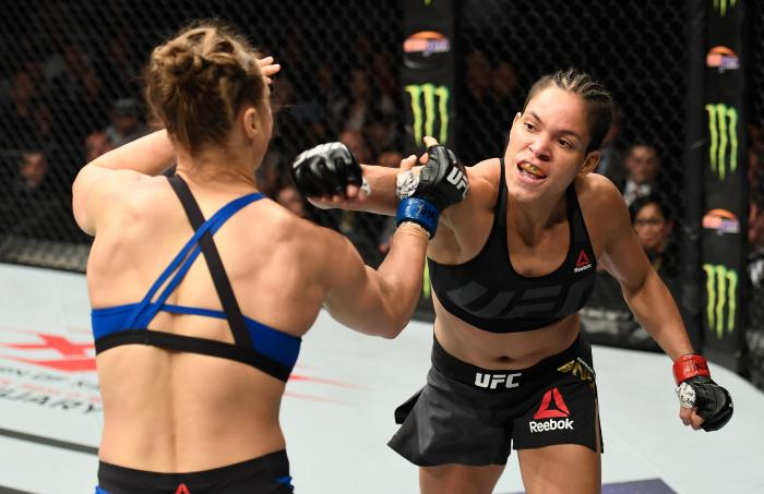Amanda Nunes throws a punch at Ronda Rousey in their UFC women's bantamweight championship bout during the UFC 207 event at T-Mobile Arena on December 30, 2016 in Las Vegas, Nevada.