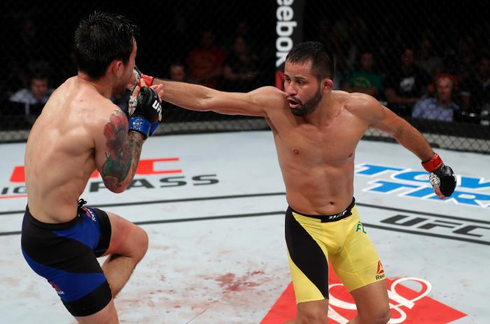 FORTALEZA, BRAZIL - MARCH 11:  (R-L) Jussier Formiga of Brazil lands a spinning back fist against Ray Borg in their flyweight bout during the UFC Fight Night event at CFO - Centro de Forma?co Olimpica on March 11, 2017 in Fortaleza, Brazil. (Photo by Buda Mendes/Zuffa LLC via Getty Images)