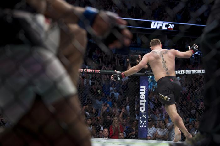 DALLAS, TX - MAY 13: Stipe Miocic celebrates after defeating Junior dos Santos during UFC 211 at the American Airlines Center on May 13, 2017 in Dallas, Texas. (Photo by Cooper Neill/Zuffa LLC/Zuffa LLC via Getty Images)