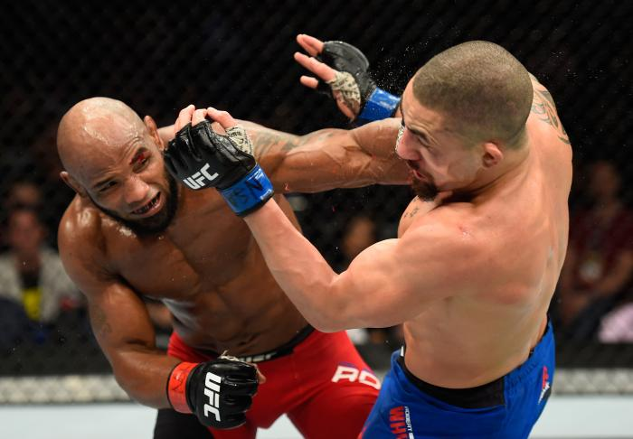Yoel Romero punches Robert Whittaker in their interim UFC middleweight championship bout during the UFC 213 event at T-Mobile Arena on July 8, 2017 in Las Vegas, Nevada.