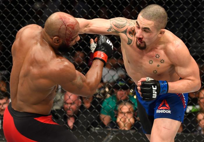 Robert Whittaker punches Yoel Romero in their interim UFC middleweight championship bout during the UFC 213 event at T-Mobile Arena on July 8, 2017 in Las Vegas, Nevada.