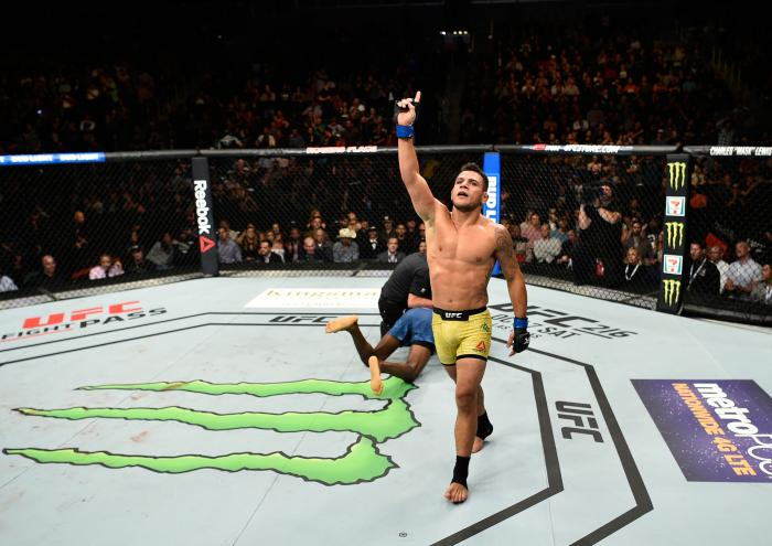 EDMONTON, AB - SEPTEMBER 09: (R-L) Rafael Dos Anjos of Brazil celebrates his submission victory over Neil Magny in their welterweight bout during the UFC 215 event inside the Rogers Place on September 9, 2017 in Edmonton, Alberta, Canada. (Photo by Jeff Bottari/Zuffa LLC/Zuffa LLC via Getty Images)