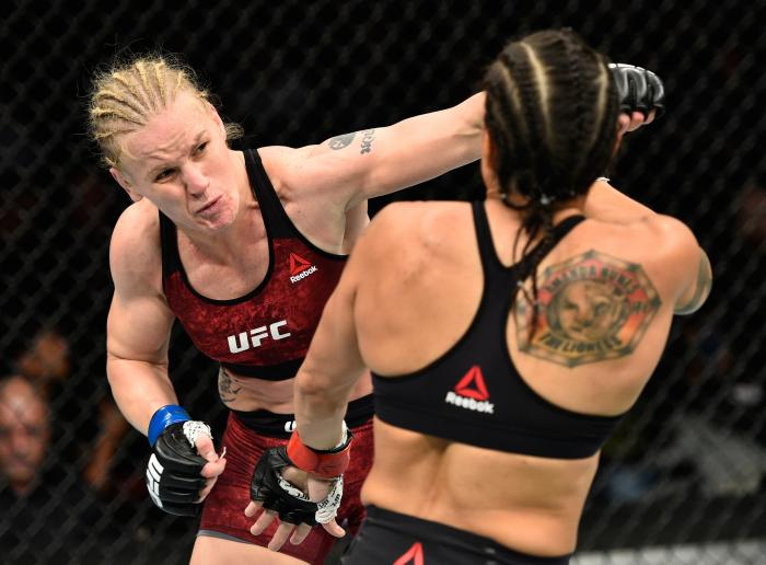 EDMONTON, AB - SEPTEMBER 09:  (L-R) Valentina Shevchenko of Kyrgyzstan punches Amanda Nunes of Brazil in their women's bantamweight bout during the UFC 215 event inside the Rogers Place on September 9, 2017 in Edmonton, Alberta, Canada. (Photo by Jeff Bottari/Zuffa LLC via Getty Images)