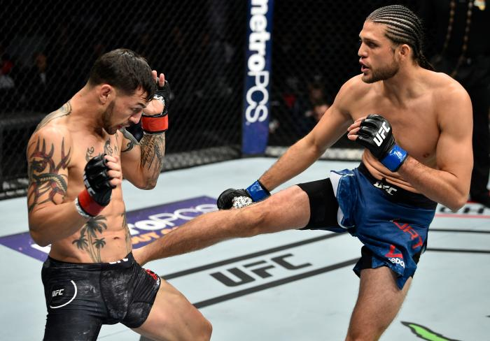 FRESNO, CA - DECEMBER 09:  (R-L) Brian Ortega kicks in their featherweight bout during the UFC Fight Night event inside Save Mart Center on December 9, 2017 in Fresno, California. (Photo by Jeff Bottari/Zuffa LLC via Getty Images)