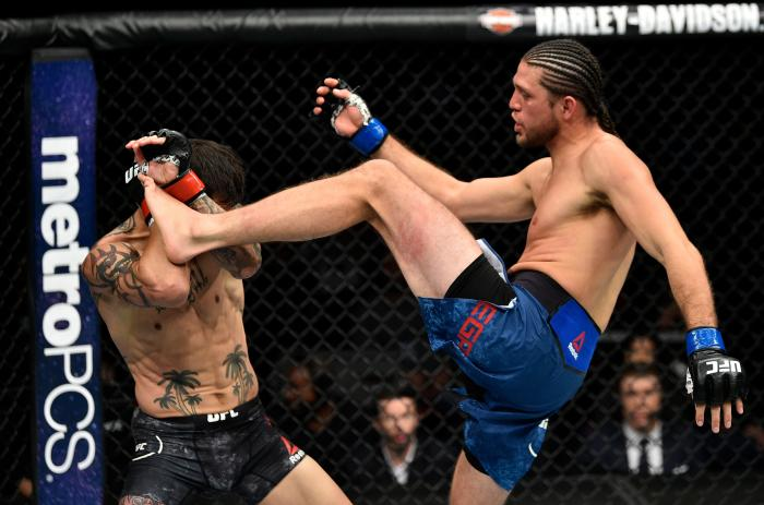 FRESNO, CA - DECEMBER 09:  (R-L) Brian Ortega kicks Cub Swanson in their featherweight bout during the UFC Fight Night event inside Save Mart Center on December 9, 2017 in Fresno, California. (Photo by Jeff Bottari/Zuffa LLC via Getty Images)