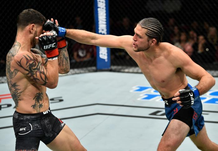 FRESNO, CA - DECEMBER 09:  (R-L) Brian Ortega punches Cub Swanson in their featherweight bout during the UFC Fight Night event inside Save Mart Center on December 9, 2017 in Fresno, California. (Photo by Jeff Bottari/Zuffa LLC via Getty Images)