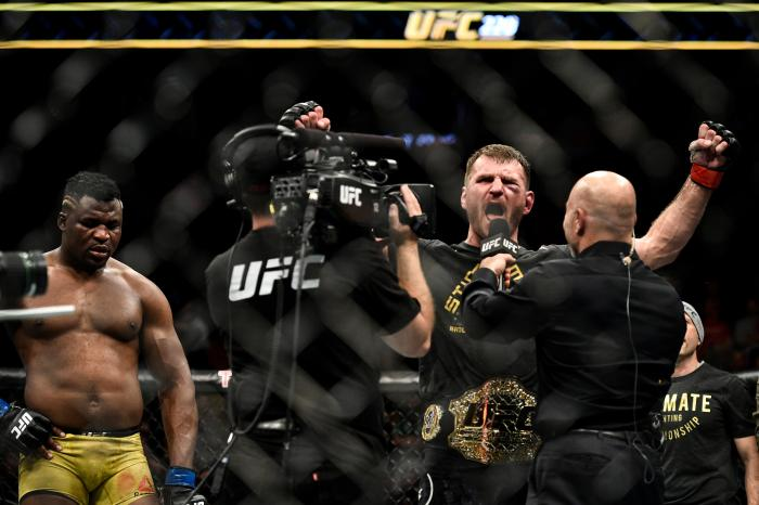 BOSTON, MA - JANUARY 20: (R-L) Stipe Miocic celebrates his victory over Francis Ngannou of Cameroon in their heavyweight championship bout during the UFC 220 event at TD Garden on January 20, 2018 in Boston, Massachusetts. (Photo by Brandon Magnus/Zuffa LLC/Zuffa LLC via Getty Images)