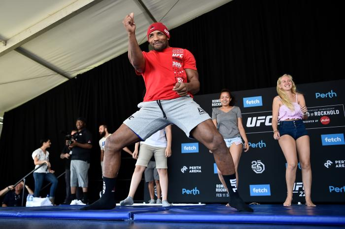 PERTH, AUSTRALIA - FEBRUARY 09:  UFC middleweight Yoel Romero of Cuba (L) invites fans to dance on stage during the UFC 221 Open Workouts at Elizabeth Quay on February 9, 2018 in Perth, Australia. (Photo by Jeff Bottari/Zuffa LLC via Getty Images)