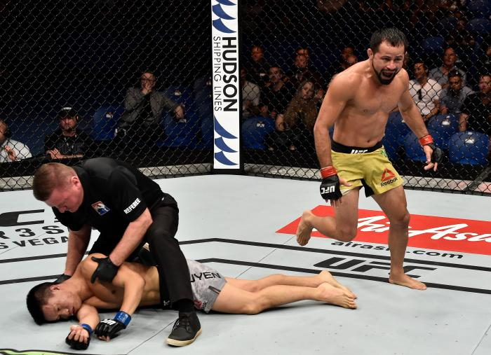 PERTH, AUSTRALIA - FEBRUARY 11:  (R-L) Jussier Formiga of Brazil celebrates his submission victory over Ben Nguyen in their flyweight bout during the UFC 221 event at Perth Arena on February 11, 2018 in Perth, Australia. (Photo by Jeff Bottari/Zuffa LLC via Getty Images)