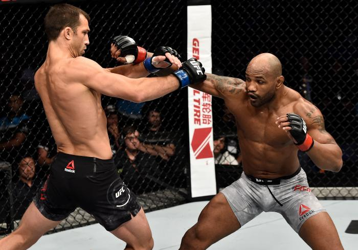 PERTH, AUSTRALIA - FEBRUARY 11:  (R-L) Yoel Romero of Cuba punches Luke Rockhold in their interim middleweight title bout during the UFC 221 event at Perth Arena on February 11, 2018 in Perth, Australia. (Photo by Jeff Bottari/Zuffa LLC via Getty Images)