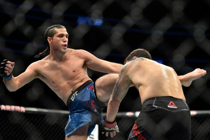 LAS VEGAS, NV - MARCH 03:   (L-R) Brian Ortega kicks Frankie Edgar in their featherweight bout during the UFC 222 event inside T-Mobile Arena on March 3, 2018 in Las Vegas, Nevada. (Photo by Brandon Magnus/Zuffa LLC via Getty Images)