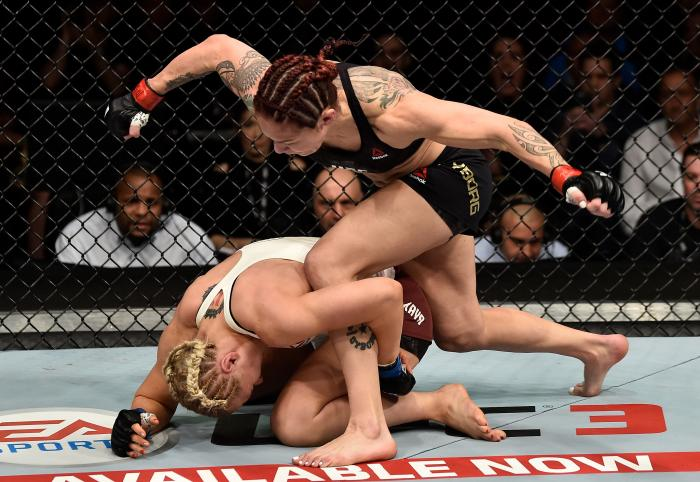 LAS VEGAS, NV - MARCH 03:   (R-L) Cris Cyborg of Brazil punches Yana Kunitskaya of Russia in their women's featherweight bout during the UFC 222 event inside T-Mobile Arena on March 3, 2018 in Las Vegas, Nevada. (Photo by Jeff Bottari/Zuffa LLC via Getty Images)