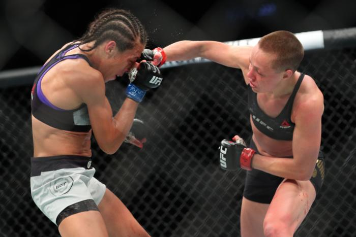 NEW YORK, NY - APRIL 07: UFC strawweight champion Rose Namajunas (R) lands a right hand to the head of Joanna Jedrzejczyk (L) during their UFC women's strawweight championship bout at UFC 223 at Barclays Center on April 7, 2018 in New York City. (Photo by Ed Mulholland/Getty Images)
