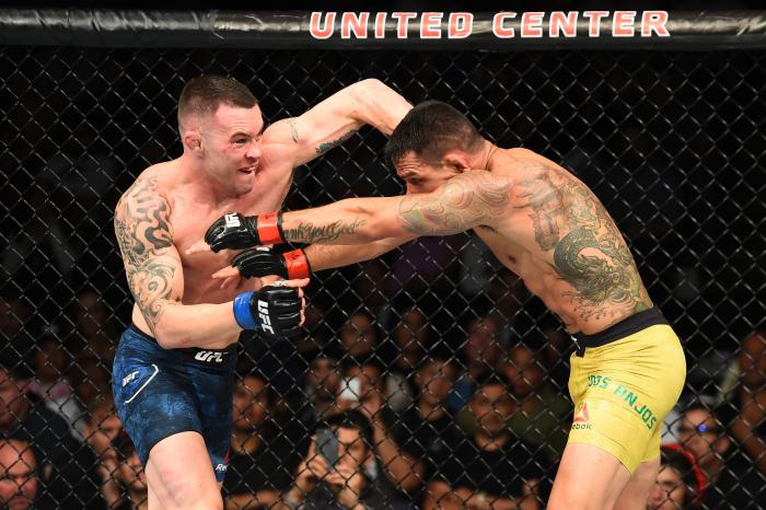 CHICAGO, ILLINOIS - JUNE 09:  (L-R) Colby Covington punches Rafael Dos Anjos of Brazil in their interim welterweight title fight during the UFC 225 event at the United Center on June 9, 2018 in Chicago, Illinois. (Photo by Josh Hedges/Zuffa LLC via Getty Images)