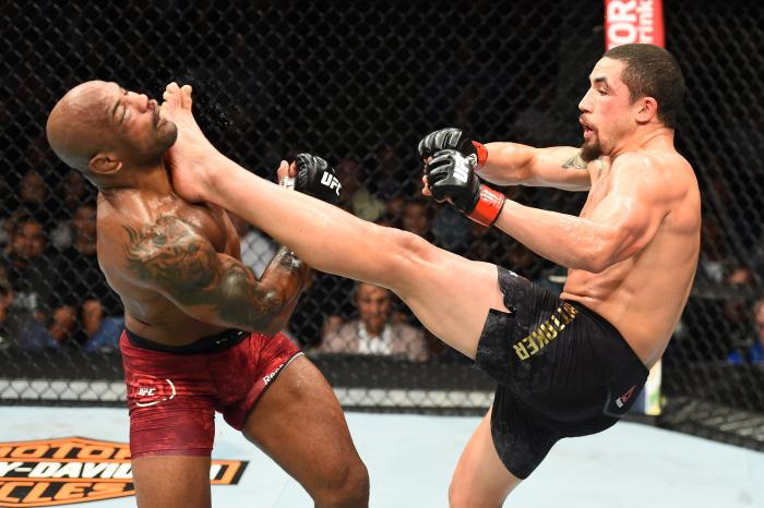 CHICAGO, ILLINOIS - JUNE 09:  (R-L) Robert Whittaker of New Zealand lands a front kick to the face of Yoel Romero of Cuba in their middleweight fight during the UFC 225 event at the United Center on June 9, 2018 in Chicago, Illinois. (Photo by Josh Hedges/Zuffa LLC via Getty Images)
