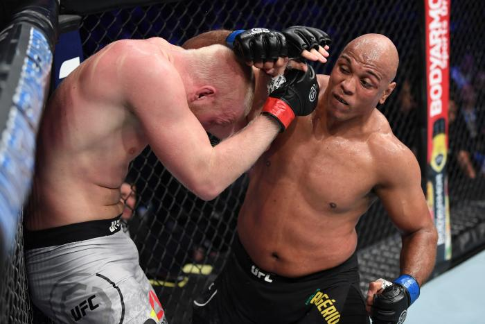 NEW YORK, NY - NOVEMBER 03:  (R-L) Marcos Rogerio De Lima of Brazil punches Adam Wieczorek of Poland in their heavyweight bout during the UFC 230 event inside Madison Square Garden on November 3, 2018 in New York, New York. (Photo by Jeff Bottari/Zuffa LLC via Getty Images)