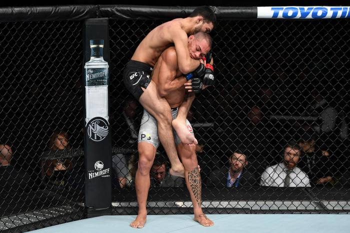 NEW YORK, NY - NOVEMBER 03:  (L-R) Julio Arce attempts to submit Sheymon Moraes of Brazil in their featherweight bout during the UFC 230 event inside Madison Square Garden on November 3, 2018 in New York, New York. (Photo by Jeff Bottari/Zuffa LLC via Getty Images)
