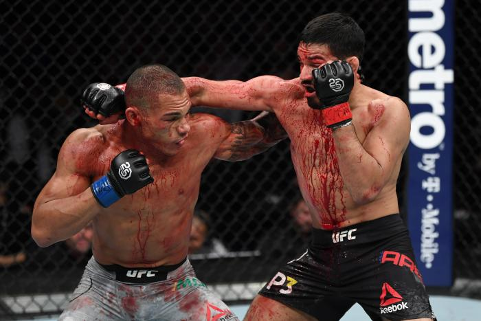 NEW YORK, NY - NOVEMBER 03:  (R-L) Julio Arce punches Sheymon Moraes of Brazil in their featherweight bout during the UFC 230 event inside Madison Square Garden on November 3, 2018 in New York, New York. (Photo by Jeff Bottari/Zuffa LLC via Getty Images)