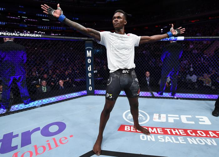 NEW YORK, NY - NOVEMBER 03:  Israel Adesanya of Nigeria celebrates his TKO victory over Derek Brunson in their middleweight bout during the UFC 230 event inside Madison Square Garden on November 3, 2018 in New York, New York. (Photo by Jeff Bottari/Zuffa LLC via Getty Images)