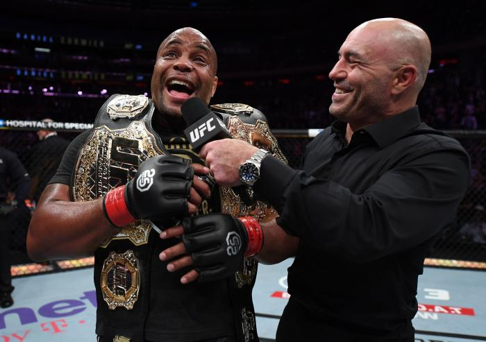 NEW YORK, NY - NOVEMBER 03:  Daniel Cormier is interviewed by Joe Rogan after his submission victory over Derrick Lewis in their UFC heavyweight championship bout during the UFC 230 event inside Madison Square Garden on November 3, 2018 in New York, New York. (Photo by Jeff Bottari/Zuffa LLC via Getty Images)