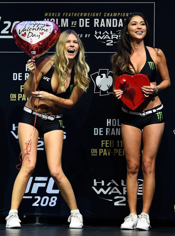 UFC Octagon Girls Chrissy Blair and Arianny Celeste smile after receiving gifts during the UFC 208 weigh-in inside Kings Theater on February 10, 2017 in Brooklyn, New York. (Photo by Jeff Bottari/Zuffa LLC)