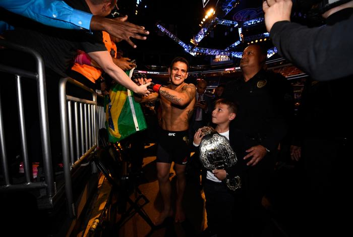 ORLANDO, FL - DECEMBER 19:   Rafael dos Anjos celebrates his TKO victory over Donald Cerrone in their UFC lightweight title bout during the UFC Fight Night event at the Amway Center on December 19, 2015 in Orlando, Florida. (Photo by Jeff Bottari/Zuffa LLC/Zuffa LLC via Getty Images)