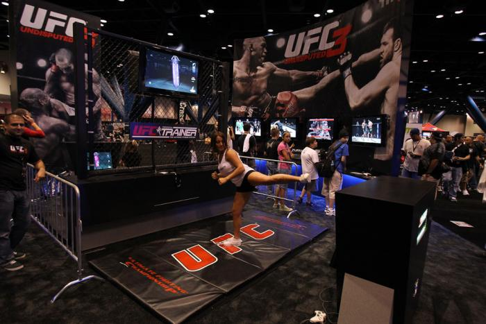 A trainer demonstrates the UFC Personal Trainer videogame
