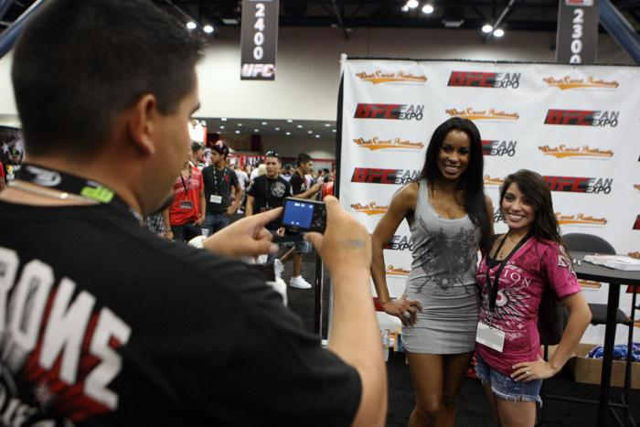 Octagon Girl Chandella Powell poses with a fan