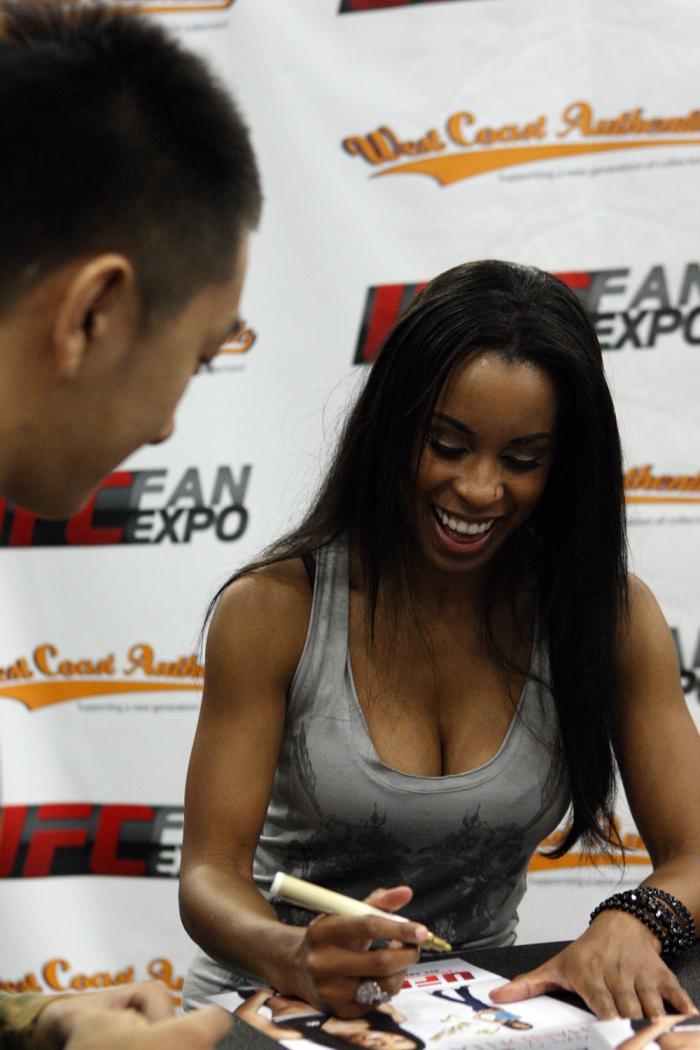 Octagon Girl Chandella Powell signs autographs