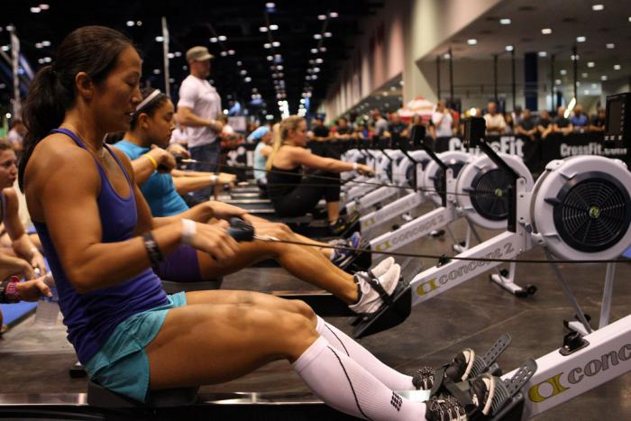 Athletes compete in the CrossFit competition at the UFC Fan Expo
