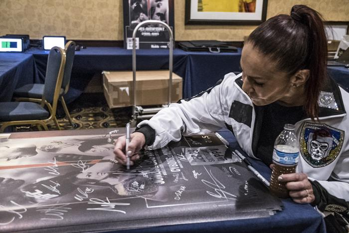 Cris Cyborg signs UFC 232 posters