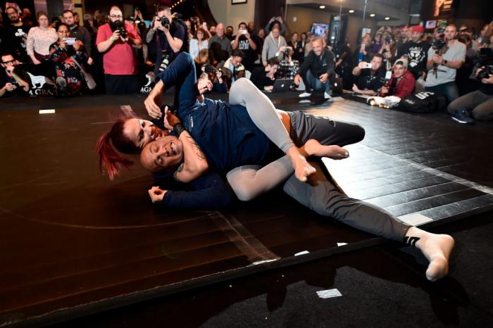 Cris Cyborg of Brazil (L) and special guest BJ Penn hold an open training session for fans and media during the UFC 222 Open Workouts at MGM Grand Hotel & Casino on March 1, 2018 in Las Vegas, Nevada. (Photo by Jeff Bottari/Zuffa LLC)