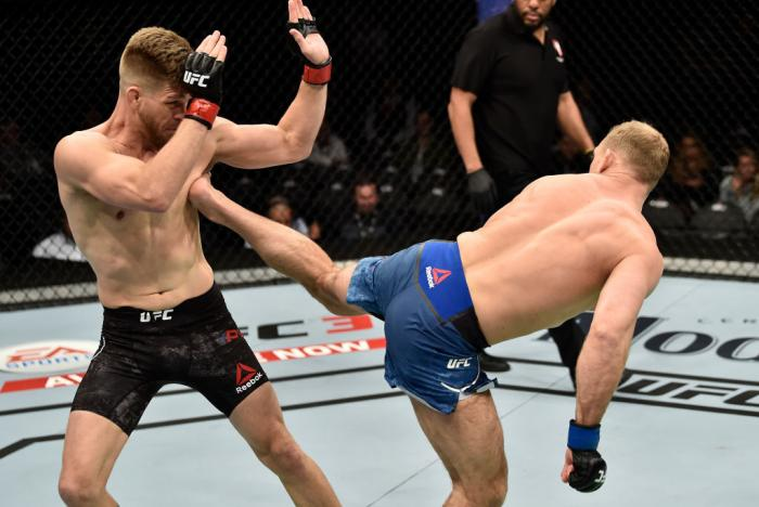 LAS VEGAS, NV - MARCH 03:   (R-L) Zak Ottow kicks Mike Pyle in their welterweight bout during the UFC 222 event inside T-Mobile Arena on March 3, 2018 in Las Vegas, Nevada. (Photo by Jeff Bottari/Zuffa LLC)