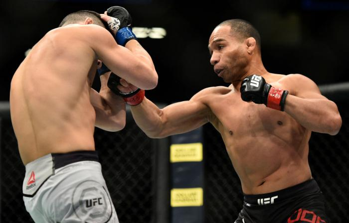 LAS VEGAS, NV - MARCH 03:   (R-L) John Dodson punches Pedro Munhoz of Brazil in their bantamweight bout during the UFC 222 event inside T-Mobile Arena on March 3, 2018 in Las Vegas, Nevada. (Photo by Brandon Magnus/Zuffa LLC)