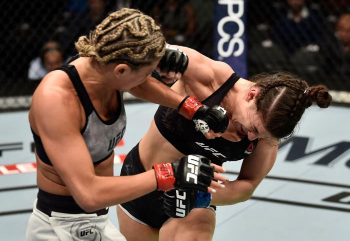 LAS VEGAS, NV - MARCH 03:   (L-R) Ashley Yoder punches Mackenzie Dern in their women's strawweight bout during the UFC 222 event inside T-Mobile Arena on March 3, 2018 in Las Vegas, Nevada. (Photo by Jeff Bottari/Zuffa LLC/Zuffa LLC via Getty Images)