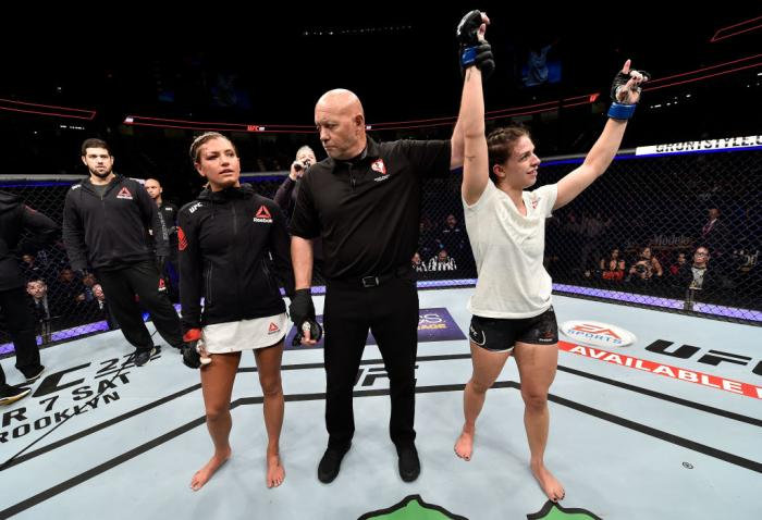 LAS VEGAS, NV - MARCH 03:   Mackenzie Dern celebrates after her split-decision victory over Ashley Yoder in their women's strawweight bout during the UFC 222 event inside T-Mobile Arena on March 3, 2018 in Las Vegas, Nevada. (Photo by Jeff Bottari/Zuffa L