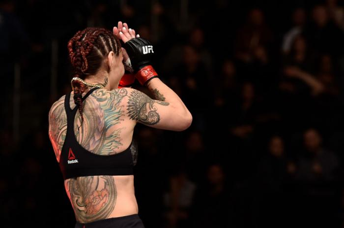 LAS VEGAS, NV - MARCH 03:   Cris Cyborg of Brazil celebrates after her TKO victory over Yana Kunitskaya of Russia in their women's featherweight bout during the UFC 222 event inside T-Mobile Arena on March 3, 2018 in Las Vegas, Nevada. (Photo by Jeff Bott