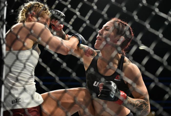 LAS VEGAS, NV - MARCH 03:   (R-L) Cris Cyborg of Brazil punches Yana Kunitskaya of Russia in their women's featherweight bout during the UFC 222 event inside T-Mobile Arena on March 3, 2018 in Las Vegas, Nevada. (Photo by Brandon Magnus/Zuffa LLC)