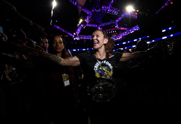 LAS VEGAS, NV - MARCH 03:   Cris Cyborg of Brazil celebrates after her TKO victory over Yana Kunitskaya of Russia in their women's featherweight bout during the UFC 222 event inside T-Mobile Arena on March 3, 2018 in Las Vegas, Nevada. (Photo by Brandon M