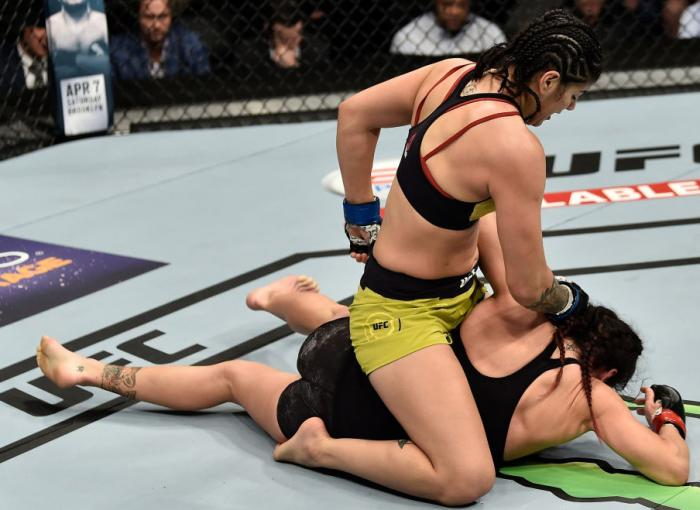 LAS VEGAS, NV - MARCH 03:   (L-R) Ketlen Vieira of Brazil punches Cat Zingano in their women's bantamweight bout during the UFC 222 event inside T-Mobile Arena on March 3, 2018 in Las Vegas, Nevada. (Photo by Jeff Bottari/Zuffa LLC/Zuffa LLC via Getty Ima