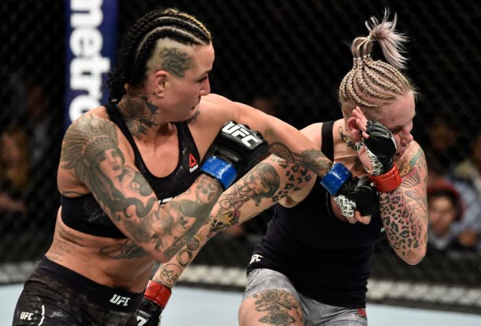BROOKLYN, NEW YORK - APRIL 07:  (L-R) Ashlee Evans-Smith punches Bec Rawlings of Australia in their women's flyweight bout during the UFC 223 event inside Barclays Center on April 7, 2018 in Brooklyn, New York. (Photo by Jeff Bottari/Zuffa LLC/Zuffa LLC v