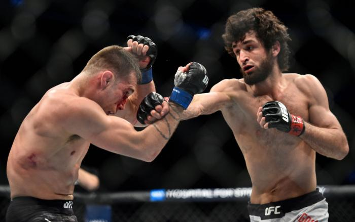 BROOKLYN, NEW YORK - APRIL 07:  (R-L) Zabit Magomedsharipov of Russia  punches Kyle Bochniak in their featherweight bout during the UFC 223 event inside Barclays Center on April 7, 2018 in Brooklyn, New York. (Photo by Brandon Magnus/Zuffa LLC/Zuffa LLC v