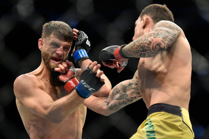 BROOKLYN, NEW YORK - APRIL 07:  (R-L) Renato Moicano of Brazil punches Calvin Kattar in their featherweight bout during the UFC 223 event inside Barclays Center on April 7, 2018 in Brooklyn, New York. (Photo by Brandon Magnus/Zuffa LLC/Zuffa LLC via Getty