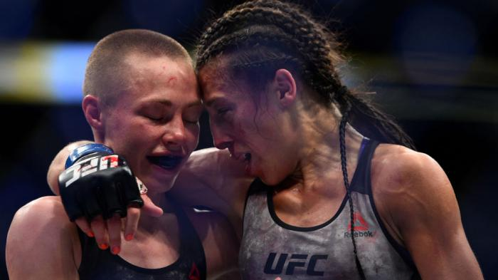 BROOKLYN, NEW YORK - APRIL 07:  (L-R) Opponents Rose Namajunas and Joanna Jedrzejczyk of Poland embraces after the conclusion of their women's strawweight title bout during the UFC 223 event inside Barclays Center on April 7, 2018 in Brooklyn, New York. (