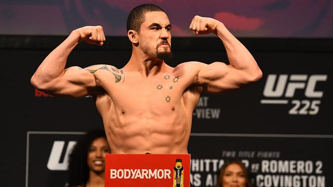 CHICAGO, ILLINOIS - JUNE 08:  UFC Middleweight Champion Robert Whittaker of New Zealand poses on the scale during the UFC 225 weigh-in at the United Center on June 8, 2018 in Chicago, Illinois. (Photo by Josh Hedges/Zuffa LLC/Zuffa LLC via Getty Images)