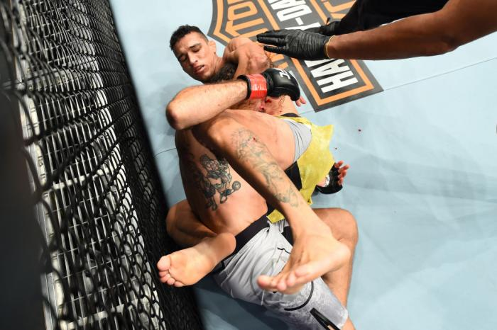 CHICAGO, ILLINOIS - JUNE 09:  (R-L) Charles Oliveira of Brazil submits Clay Guida in their lightweight fight during the UFC 225 event at the United Center on June 9, 2018 in Chicago, Illinois. This submission ties the all-time UFC record held by Royce Gra