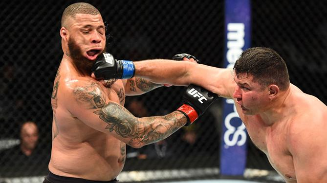 CHICAGO, ILLINOIS - JUNE 09:  (R-L) Chris De La Rocha punches Rashad Coulter in their heavyweight fight during the UFC 225 event at the United Center on June 9, 2018 in Chicago, Illinois. (Photo by Josh Hedges/Zuffa LLC/Zuffa LLC via Getty Images)