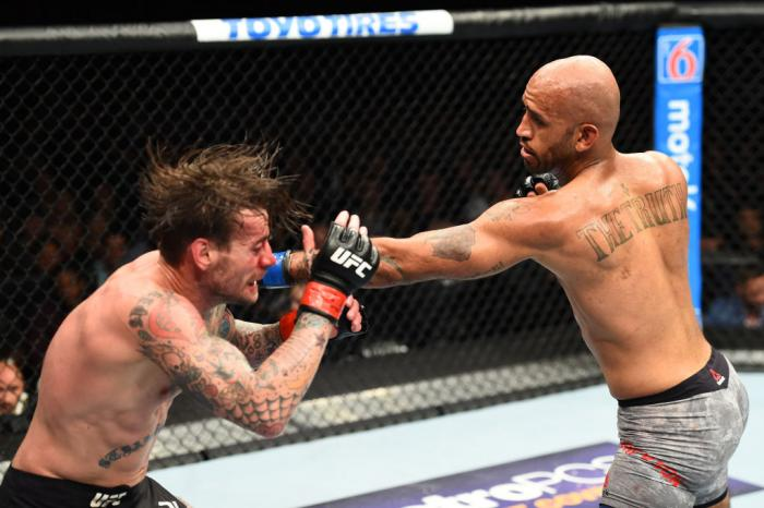 CHICAGO, ILLINOIS - JUNE 09:  (R-L) Mike Jackson punches CM Punk in their welterweight fight during the UFC 225 event at the United Center on June 9, 2018 in Chicago, Illinois. (Photo by Josh Hedges/Zuffa LLC/Zuffa LLC via Getty Images)
