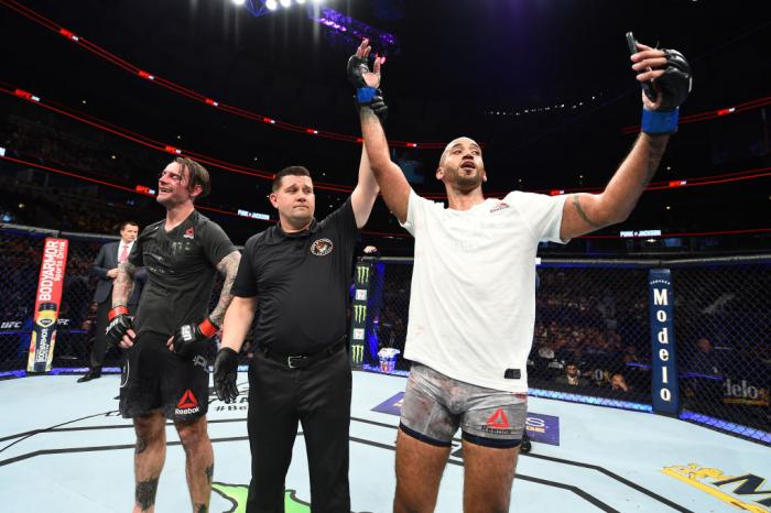 CHICAGO, ILLINOIS - JUNE 09:  (R-L) Mike Jackson celebrates after defeating CM Punk in their welterweight fight during the UFC 225 event at the United Center on June 9, 2018 in Chicago, Illinois. (Photo by Josh Hedges/Zuffa LLC/Zuffa LLC via Getty Images)