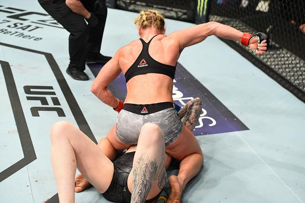 CHICAGO, ILLINOIS - JUNE 09:  (L-R) Holly Holm controls the body of Megan Anderson of Australia in their women's featherweight fight during the UFC 225 event at the United Center on June 9, 2018 in Chicago, Illinois. (Photo by Josh Hedges/Zuffa LLC/Zuffa